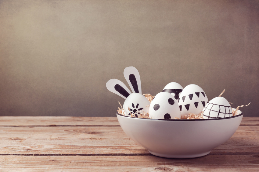Easter eggs with hand drawing ornament on wooden table