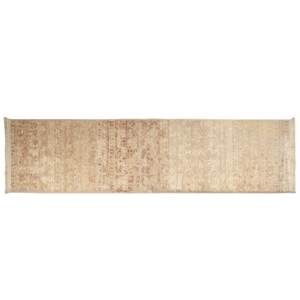 Tapis beige contemporain à franges